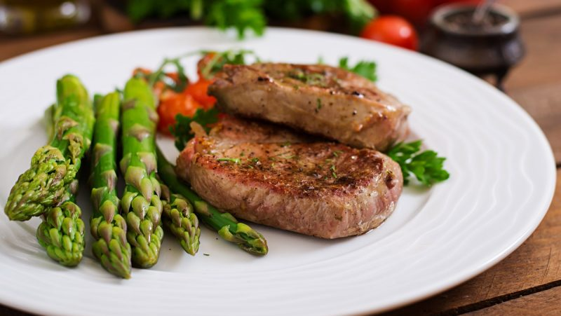 barbecue-grilled-beef-steak-meat-with-asparagus-tomatoes_web